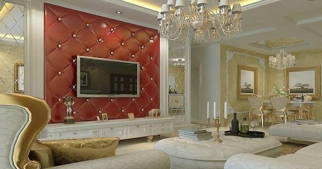 2/3 华丽的吊灯、优雅的沙发,嵌入金黄色边纹的欧式沙发,更具奢华气度。红色软包客厅液晶电视背景墙,抢尽了风头成为了客厅中的主角。欧式电视背景墙,用金色的圆钉将软包隔出一个个菱形图案,简约中不失华丽感。液晶电视机,不经意间成为了欧式电视背景墙的一部分,保持尊贵感的同时又不失时尚品位。