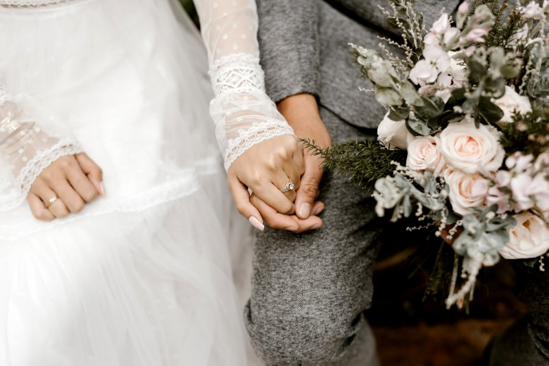 bride-and-groom-holding-hands-2959190
